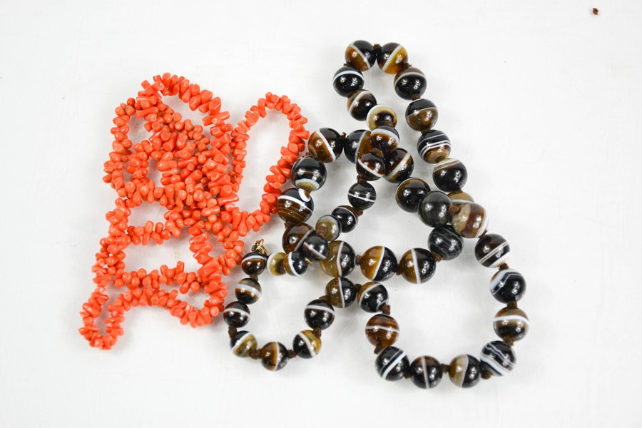 A coral and an agate beaded necklace.