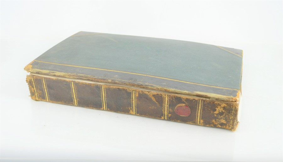 An Edwardian and later scrap book with various cuttings and pictures