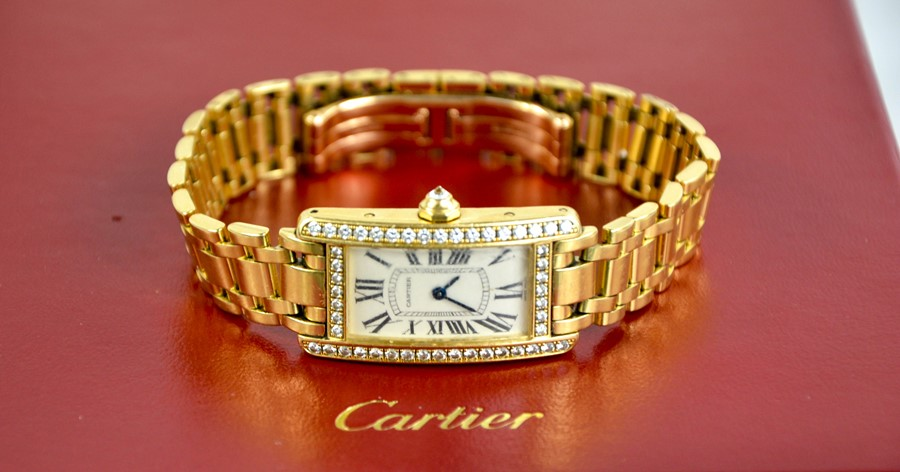 An 18ct gold and diamond Cartier wristwatch, in the Tank Americaine design, silver grained dial - Image 3 of 6