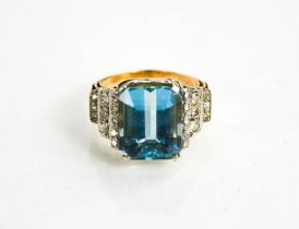 A gold, platinum, aquamarine and diamond ring, the rectangular cut aquamarine approximately 9cts,