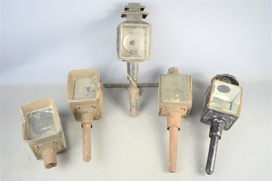 A group of five Victorian carriage lamp lights, one has been converted to electricity