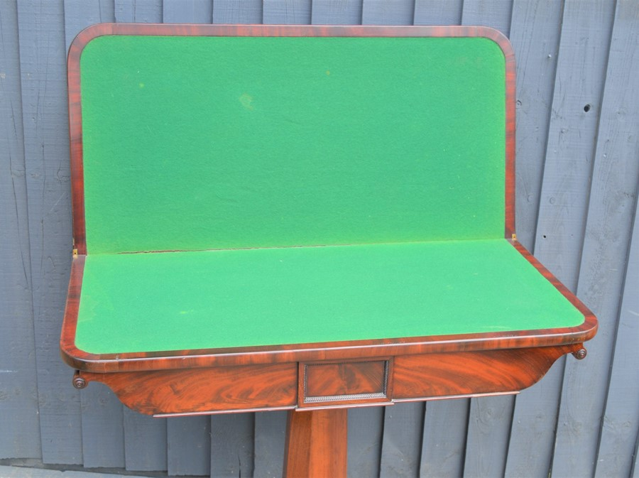 A mahogany card table with swivel top, green baize lining and x-form base, 75cm high by 92cm wide by - Image 3 of 4