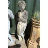 A Classical style garden statue, female figure.