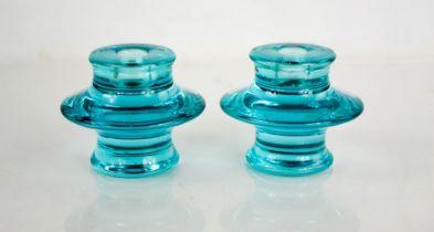 A pair of blue glass candlesticks. 9.5cms tall