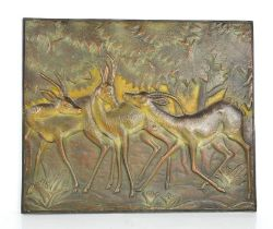 An Art Deco bronzed plaque depicting gazelle in a forest, indistinctly signed S De Corvini? 43cms by