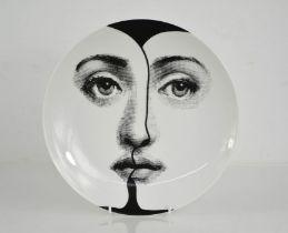 A Fornasetti Tera Veriazione display plate, 'Julia' no 271, 27cm diameter.