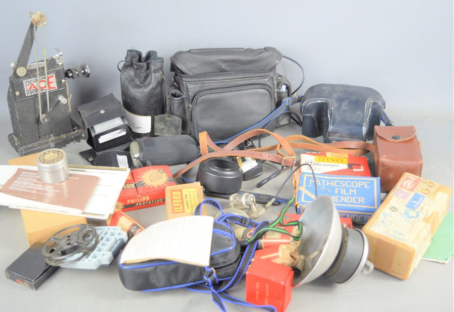 A group of vintage cameras, lens and some accessories to include, Minolta 7000 and Sigma 70mm-