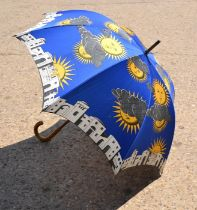 A Fornasetti umbrella, Soli e Lune, bearing makers plaque to the handle.