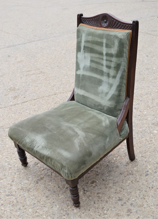 A Victorian nursing upholstered in green upholstery