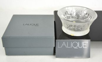 A Lalique glass bowl, embossed with tigers, with original box. 11.5cms diameter