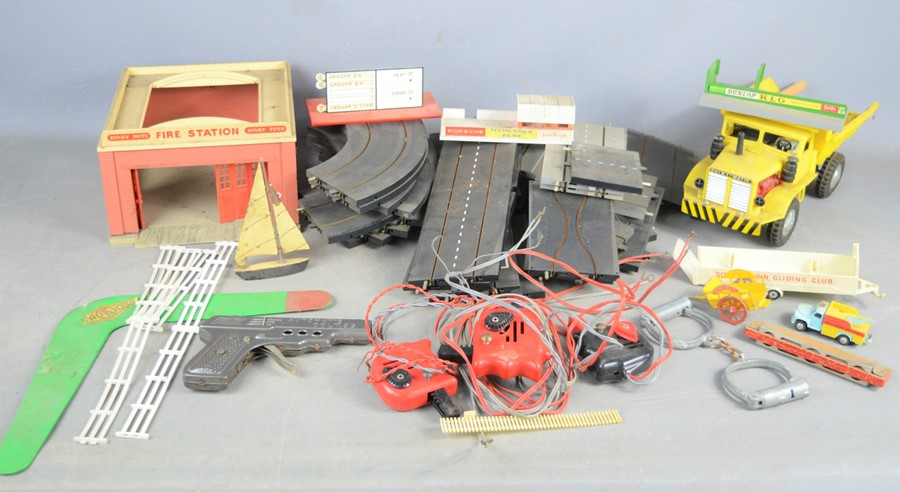 A vintage Triang mimic motorways part set to include cars, track and controller, a toy gun and a