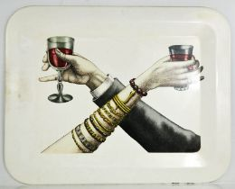A large white Fornasetti tray with hands holding wine goblets, 48cms x 60cms
