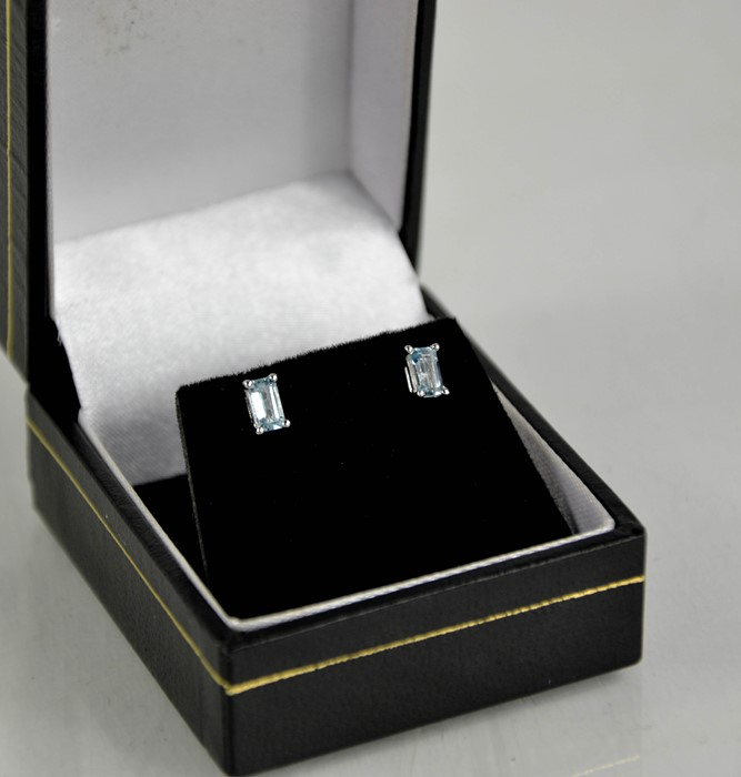 A pair of 18ct white gold and aquamarine earrings, emerald cut.