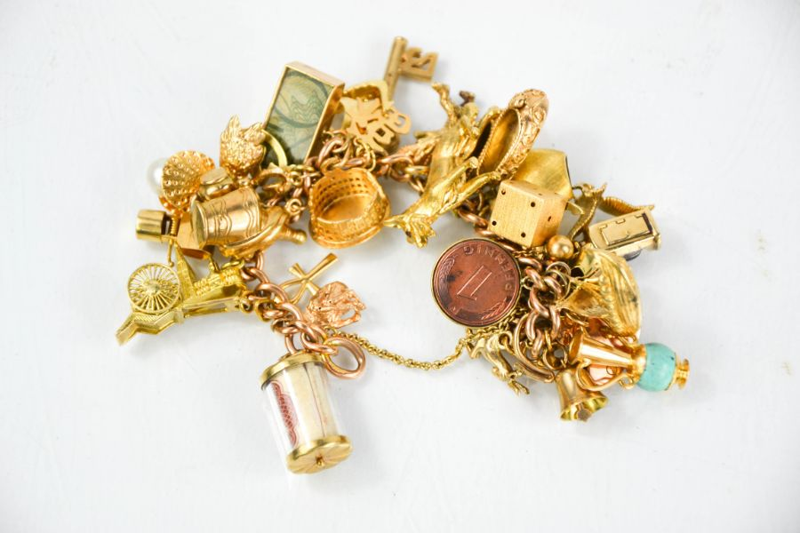 A 9ct gold charm bracelet, 97g.