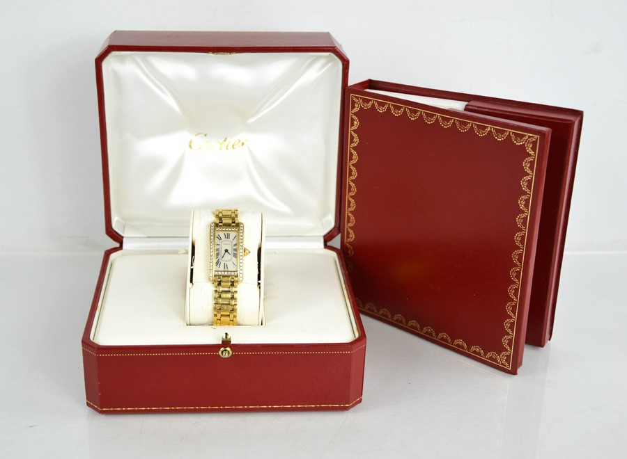 An 18ct gold and diamond Cartier wristwatch, in the Tank Americaine design, silver grained dial