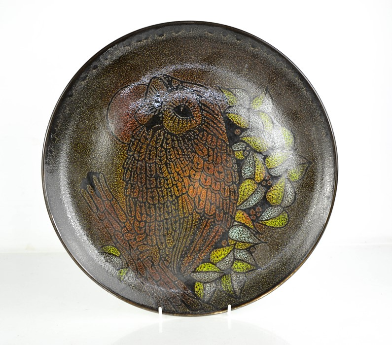 A Poole pottery charger depicting an owl.