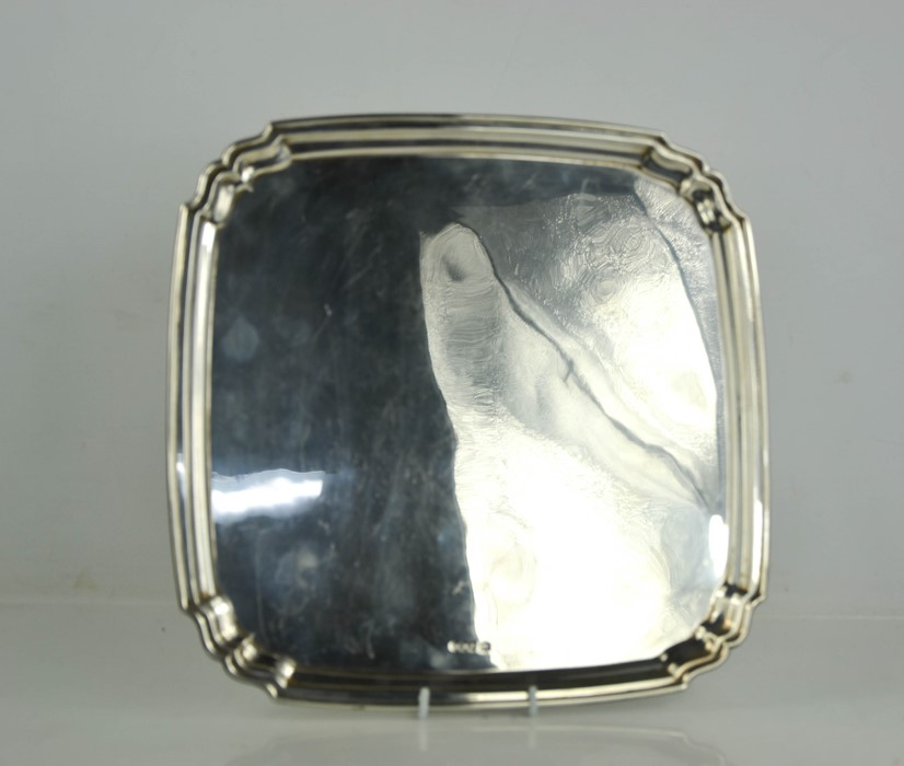 A George V silver salver by Robert Stewart, Sheffield 1930, of square form, on disc feet, with - Image 2 of 2