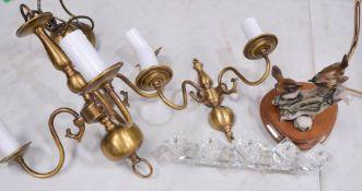 A Leonardo lamp, brass chandelier and wall light.
