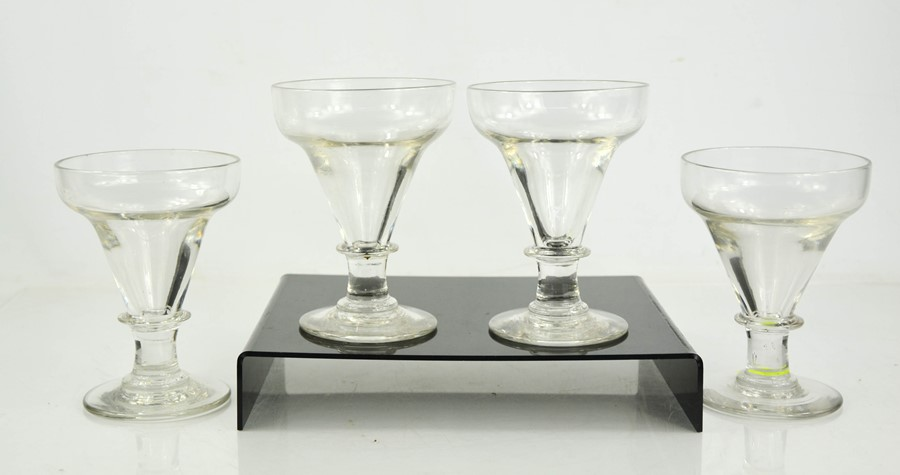 A set of four glasses, 19th century, 15cm high.