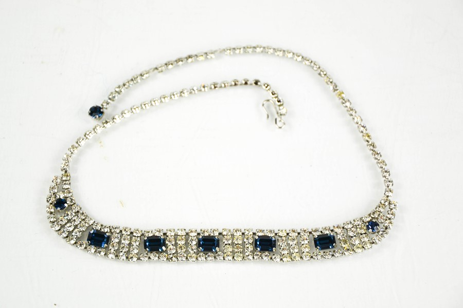 A diamante dress necklace, in a diamond and sapphire style.