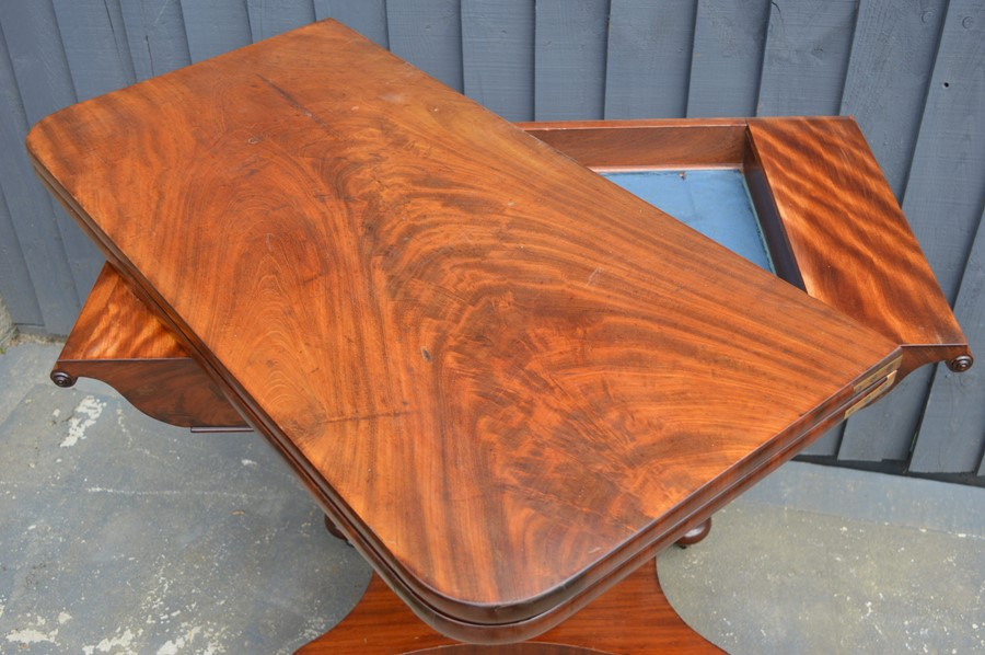 A mahogany card table with swivel top, green baize lining and x-form base, 75cm high by 92cm wide by - Image 4 of 4