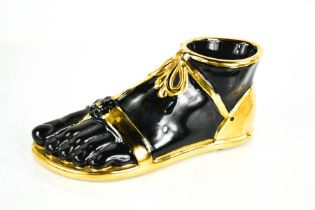 A Fornasetti black 'Piede Romano' foot, 21cms long