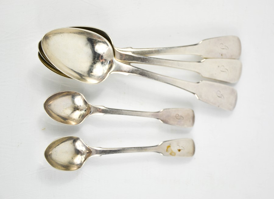 Three Georgian silver dessert spoons and two silver teaspoons London 1850, all engraved with the