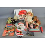 A group of vintage toys and dolls to include a Betty Boop bag, German bisque dolls head etc
