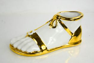 A Fornasetti white 'Piede Romano' foot, 21cms long