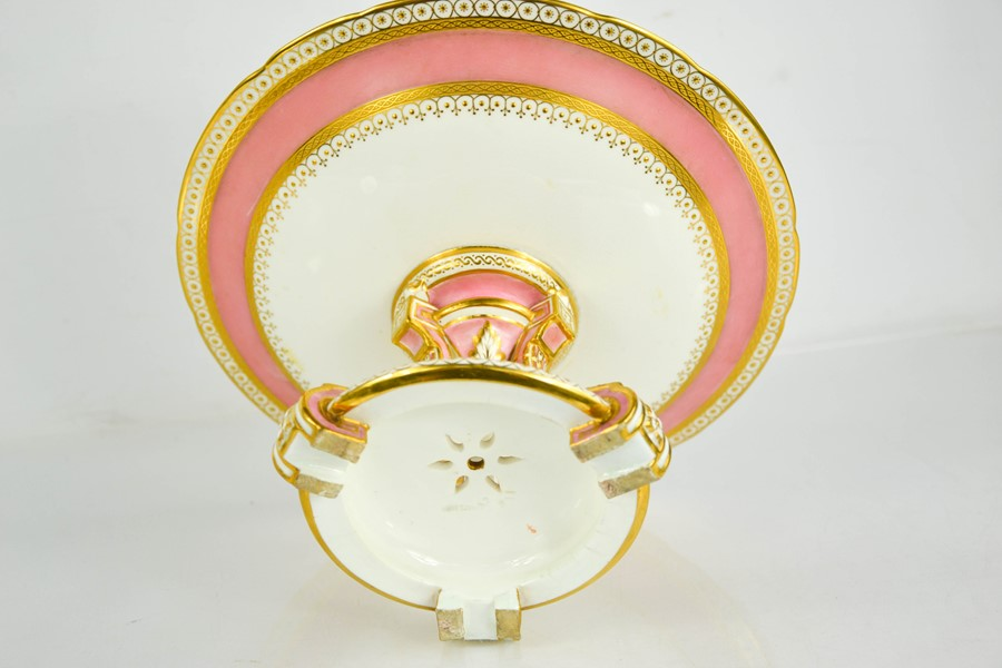 A 19th century Minton porcelain comport, with a pink ground, enhanced with gilded decoration, raised - Image 2 of 2
