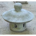 A granite Chinese style pagoda form garden incense burner. 37cms