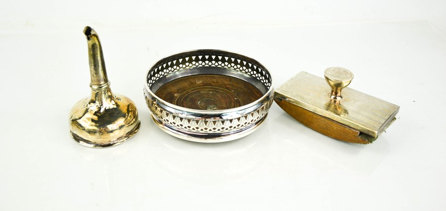 A silver wine coaster with wooden base and pierced sides, London 1970, a silver blotter and an A/F