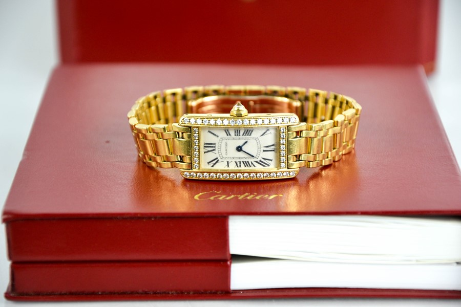 An 18ct gold and diamond Cartier wristwatch, in the Tank Americaine design, silver grained dial - Image 4 of 6