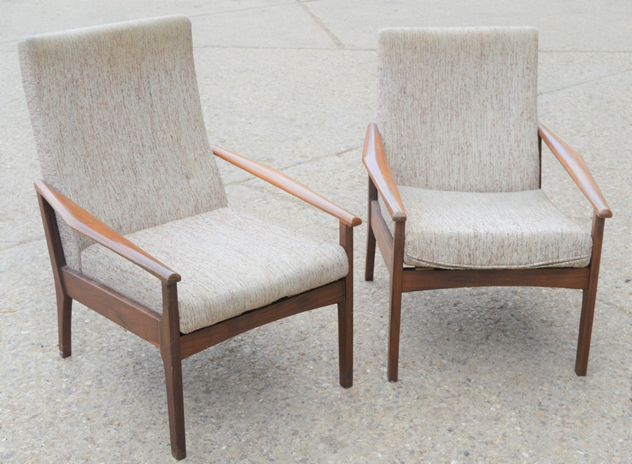 A pair of Mid-Century Danish style teak lounge chairs, 82cm high by 63cm wide by 51cm