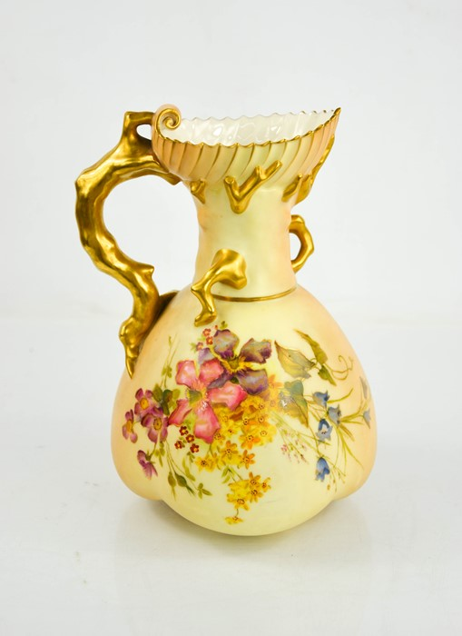 A Royal Worcester blush ivory jug painted with flowers, with a coral gilt handle, date code 1903,