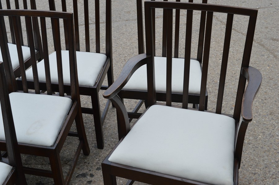A set of twelve dining chairs including two carvers, with drop in seats, stamped. - Image 2 of 4