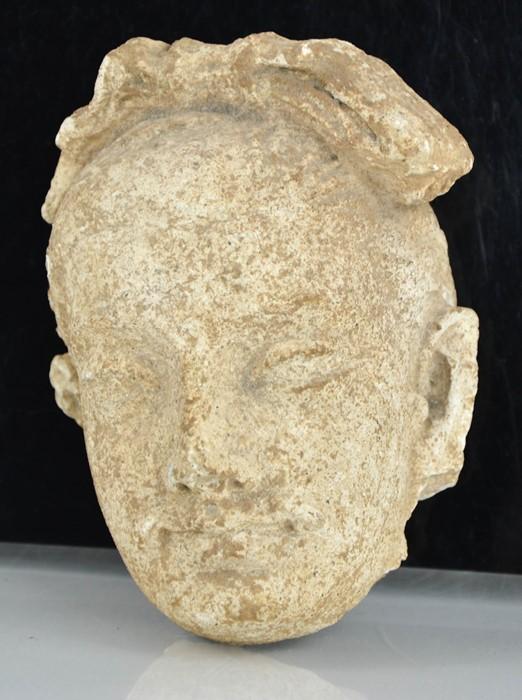 A rare Gandhara carved stone head, circa 2000BC 16cm high.