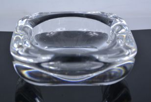 A Holmegaard glass ashtray, etched with signature to the base, 16cm diameter.