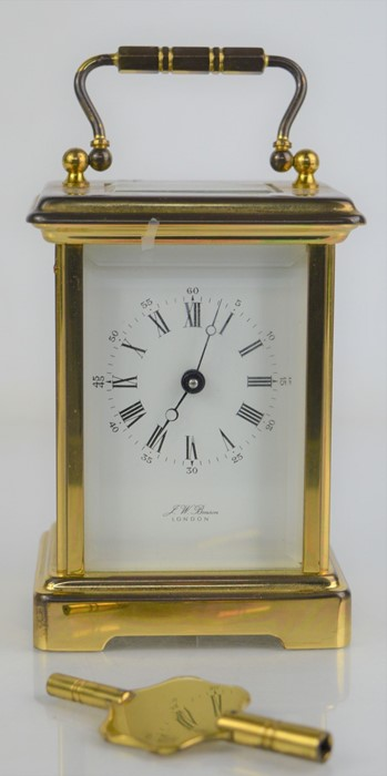A J.W Benson of London brass cased carriage clock with roman numeral dial, with key