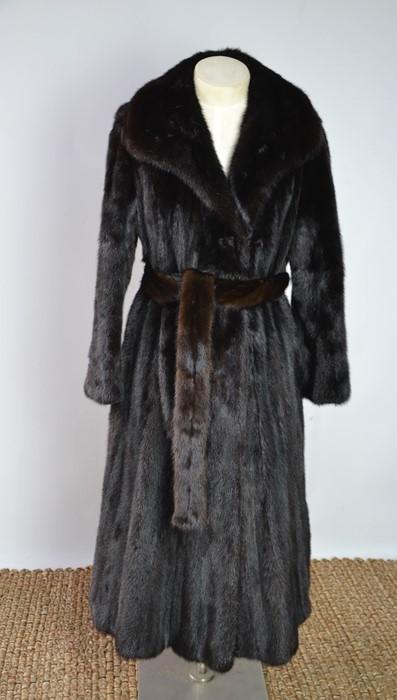 A full length mink coat and belt, in the original bag, size 10-12