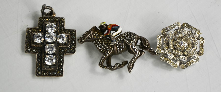 Three brooches, to include a silver, marcasite and enamelled example in the form of a horse and