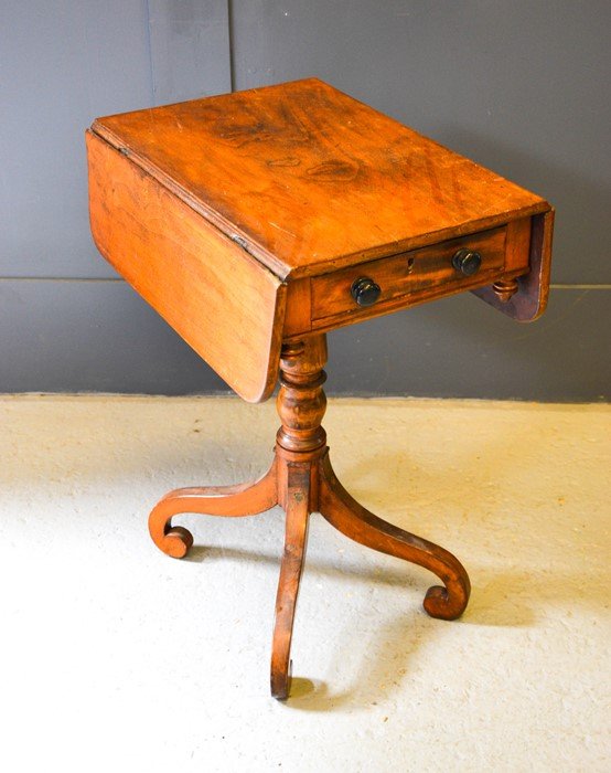 A 19th century Pembroke table, with single drawer, drop leaves and raised on four scroll feet. 67 by