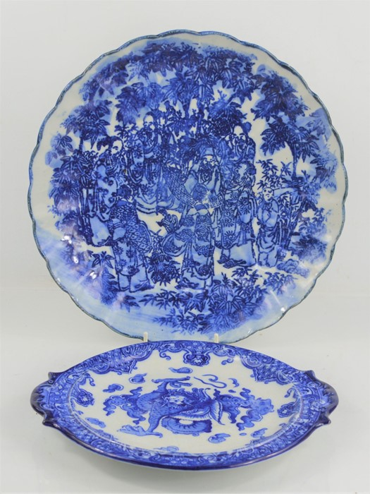 A 19th century Chinese blue and white charger with scalloped edge depicting figural scenes