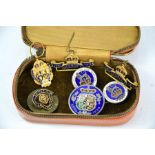 A group of various badges to include Royal British Legion, Coronation of Queen Mary and other