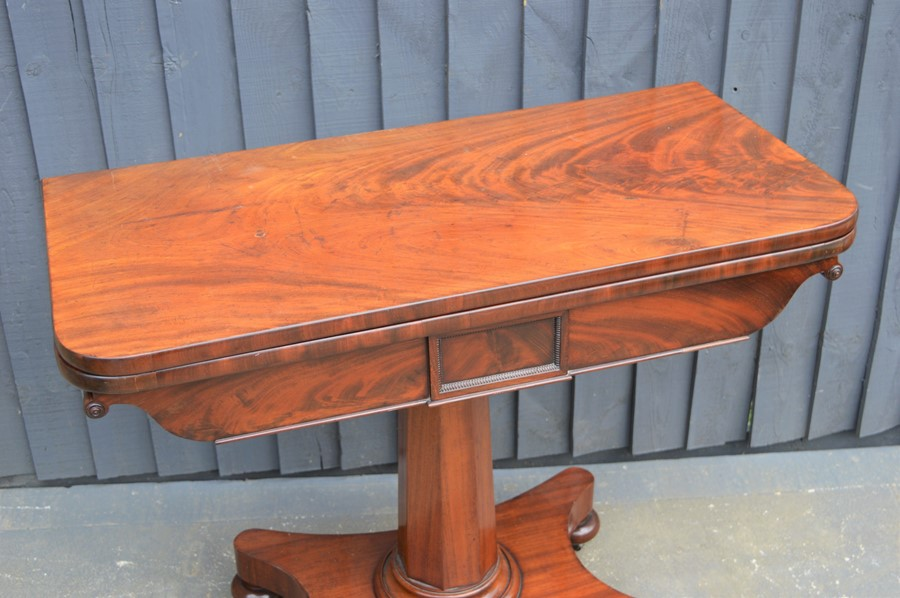 A mahogany card table with swivel top, green baize lining and x-form base, 75cm high by 92cm wide by - Image 2 of 4