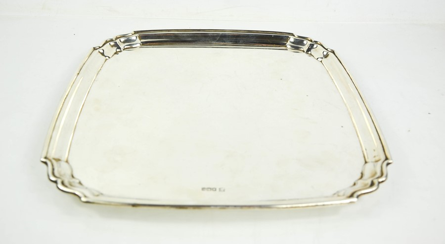 A George V silver salver by Robert Stewart, Sheffield 1930, of square form, on disc feet, with