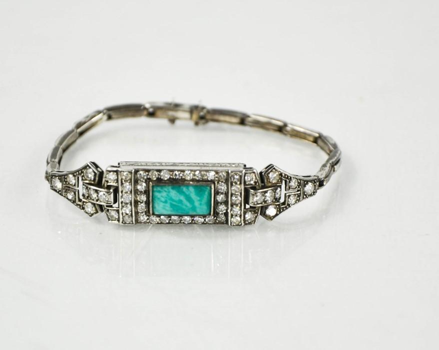 An Art Deco platinum, diamond and jadite wristwatch, lacking mechanism, 17g.