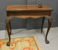 A 19th century mahogany Chippendale style card table, carved with blind fret work frieze, above