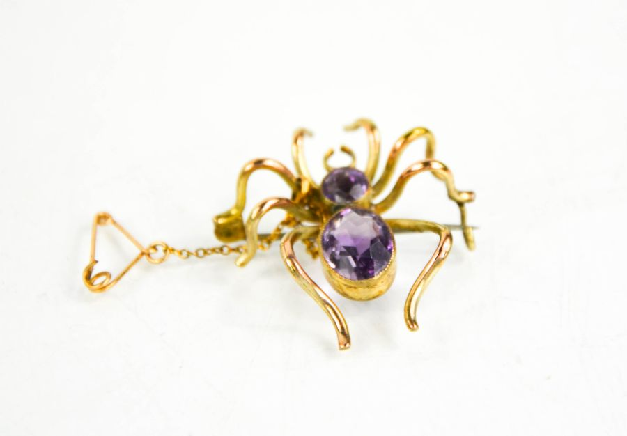 A 9ct gold spider brooch set with amethyst, 4.5cms x 3cms , 5.3g.
