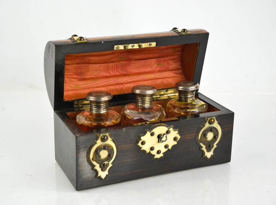 A 19th century coromandel scent casket, circa 1870, with domed lid and brass strapwork, overlain